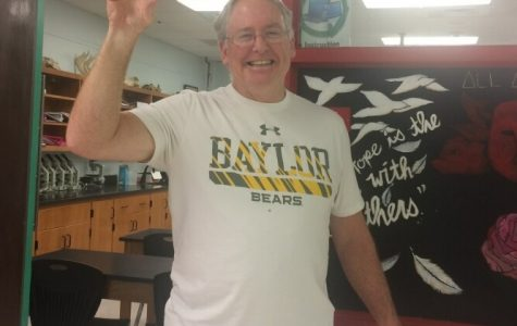 Mr. Guthrie poses with a Baylor t-shirt, a big bear claw and an even bigger smile. Such a proud Papa Bear of his daughter, Sloane, who attends Baylor University.