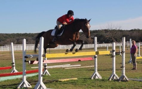 Madi Wahrmund shows off her skills during one of the many riding shows she has competed in.