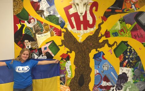 Repping her Ukranian flag in front of the FHS mural, Stacy Kosova is thrilled to be a part of the FLEX program and experience the American culture.