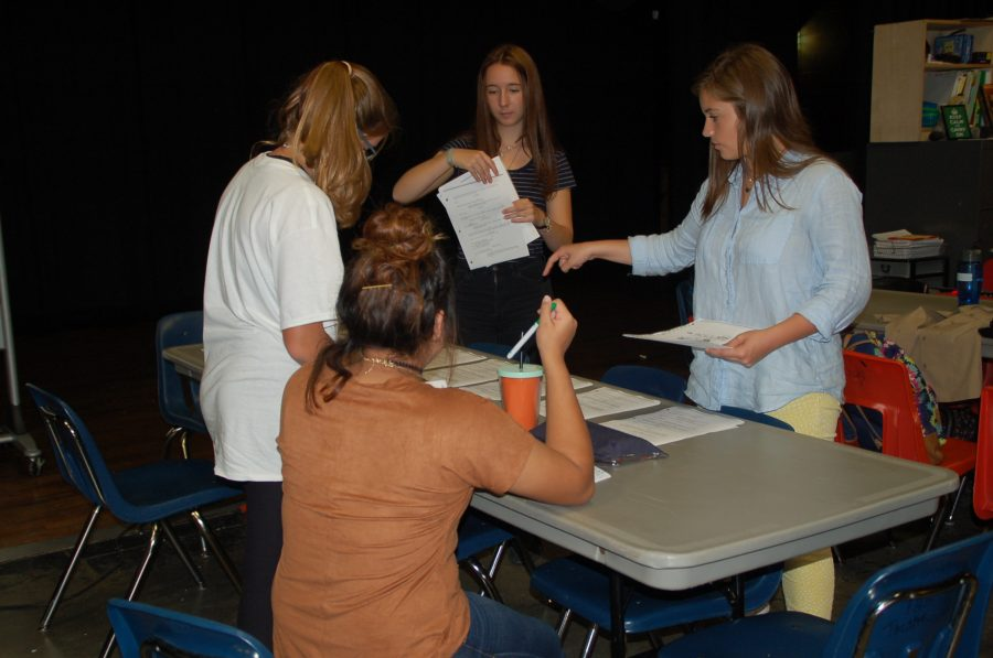 Katya Walker, Vanessa Viveros, Camille Rhyne and Sina Folk, who are members of One Act, put scripts together.