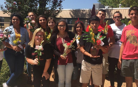 Members of HOSA show off the flowers that they arranged to take to hospice patients.