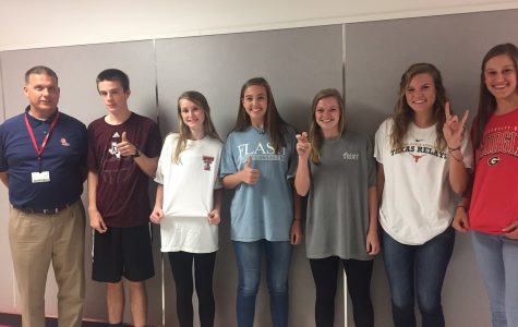 Sporting their college t-shirts are Mr. Halderman, Christian Turner, Aleah Constantine, Jessica Hardin, Larkin Penn, Molly Pluenneke and Rose Stuewe.