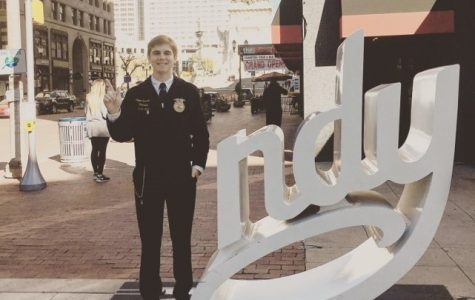 Senior Colton Snedecor takes time between FFA National Convention committee meetings to pose for a picture in Indianapolis.
