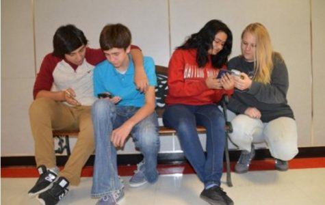 Tomas Albiter, Caleb Behrends, Crystal Romero and Alivia Armistead enjoy spending time on their phones using social media.
