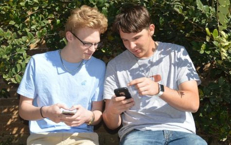 Ryan Segner shows Dustin Nielsen his Snapchat streaks. Some students have become obsessive with their streaks while others feel that they are a waste of time.