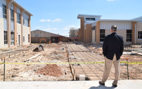 Superintendent Dr. Eric Wright looks out on the construction before the sidewalks were poured.  The new area is now available for students to use as walkways to and from the gym.