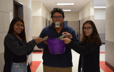 FHS students, Alexandra Martinez, Edward Guajardo and Lesly Meza demonstrate the kindness shown by the Fredericksburg community in giving donations to Port Aransas High School.