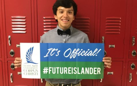 Senior Alejandro Contreras smiles with his acceptance banner for his Corpus Christi dream.