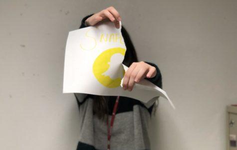 Abbey Eckhardt tears a symbolic representation of Snapchat's latest mistake.