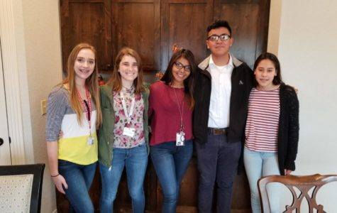 Camryn Mikosh, Calissa Vollmar, Alexandra Martinez Garcia, Efrain Gonzales and Kiarelys Rosa Ruiz presented their group's project to CelesteCare Assisted Living and Memory Care in Fredericksburg.
