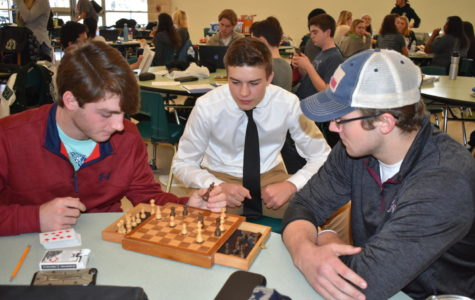 Josh Handley, Clay Crouse and Eston Epton take a break from UIL competitions to engage in a friendly game of chess.