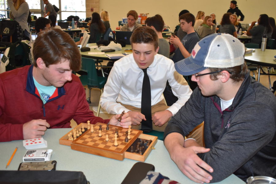 Josh+Handley%2C+Clay+Crouse+and+Eston+Epton+take+a+break+from+UIL+competitions+to+engage+in+a+friendly+game+of+chess.