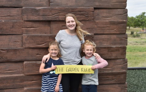Abbey Zschappel with kindergartners, Lila and Leah, demonstrates that kids of all ages should know and follow the Golden Rule.