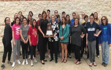 Members of the FHS choir and Mrs. Stehling stand with theri Sweepstakes award.