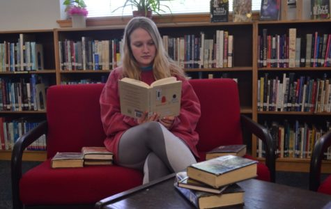 Abbey Zschappel reads Eleanor and Park, which is available in the FHS library.