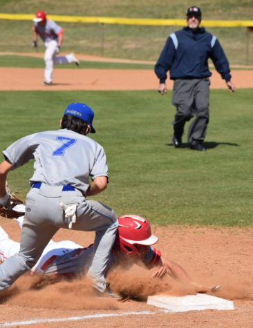 Daylon Nebgen slides into third base.
