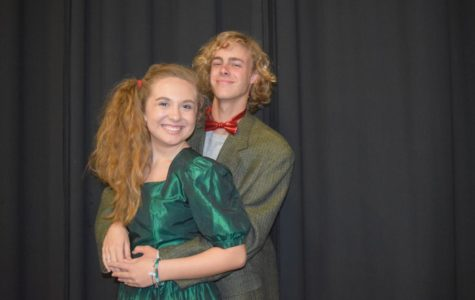 Sophomores Mariah Boyd and Graham Hammond pose for a cute but awkward prom picture.