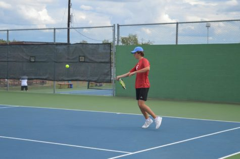 Junior Troy Kneese gets ready to hit a forehand against Kerrville Tivy.