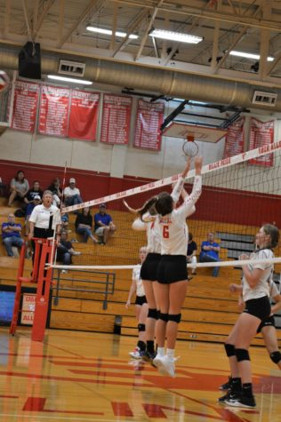 The Billies go up for a block against La Vernia.