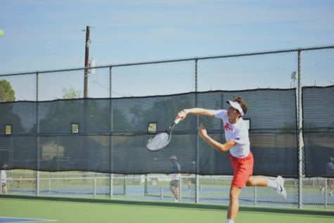 Senior Levi Wilkins hit a serve against district opponent, Canyon Lake.