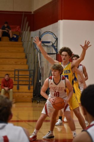 Dalton Rabon looks to pass the ball out for a three.  Rabon helped the Billies to a 73-47 win over Lago Vista.
