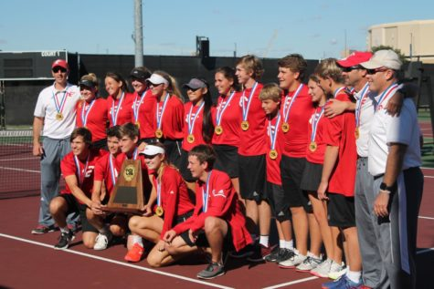 The varsity tennis team poses with their plaque after winning the 4a state team tennis title.