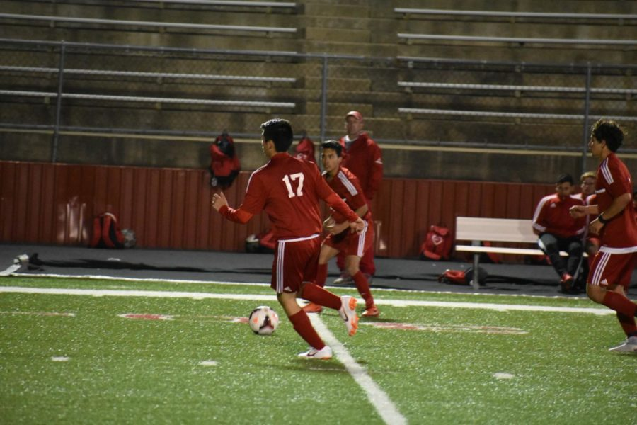Billies varsity player 17 gears up to kick the soccer ball.