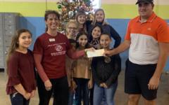 Schneider Goes Big, Raises $1500 for Boys and Girls Club