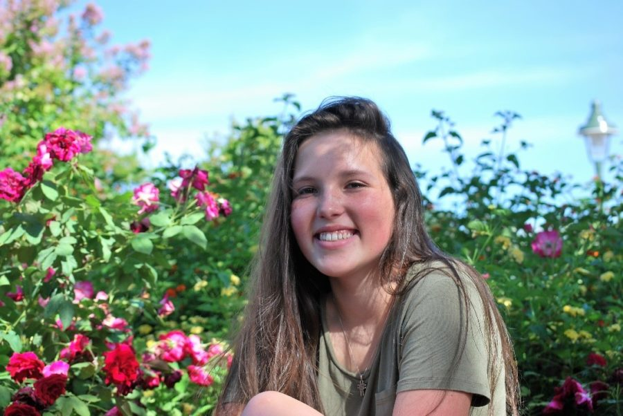 Mackenzie Keeter, a student at Fredericksburg High School, helps her family produce and sell crosses for their business.