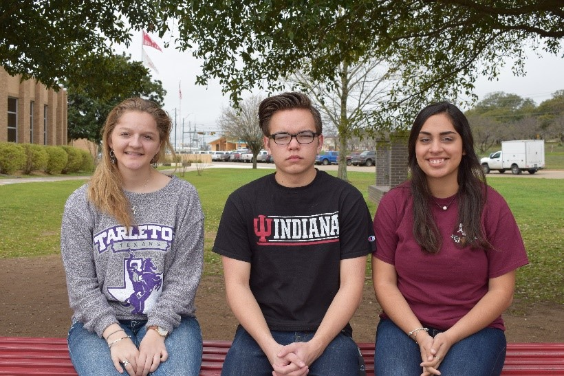Kamryn Manley, Bryce Pearrow and Jenna Najera sport their college shirts.