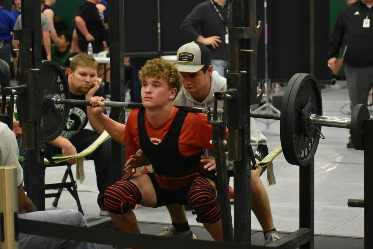 Freshman John Tewksbury squats during the Lago Vista meet.