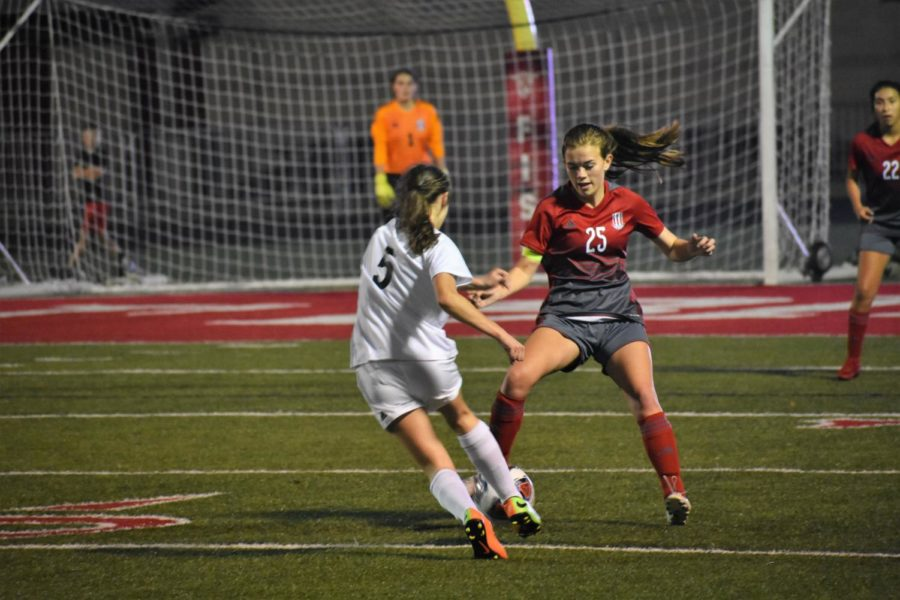 Girls' Soccer Loses Players but Fights Through District