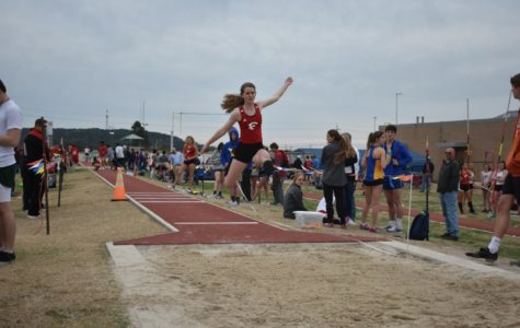 Aleah Constantine flies over the long jump pit during her event at the Kerrville track meet.