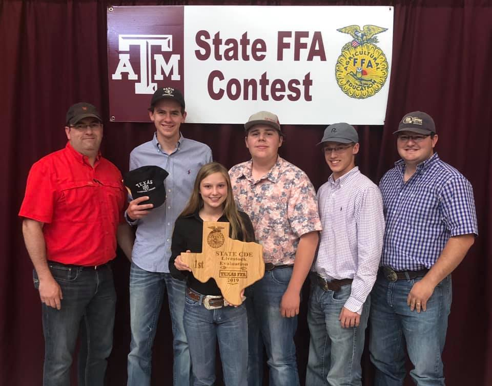 The livestock judging team of Caleb Behrends, Kayla Feller, Wyatt Geistweidt and Jacob Jensche placed first at state advancing them to the National FFA Convention in Indianapolis on Oct. 30- Nov.2. Patrick Padgett and Taylor Osbourne congratulate them on their win.