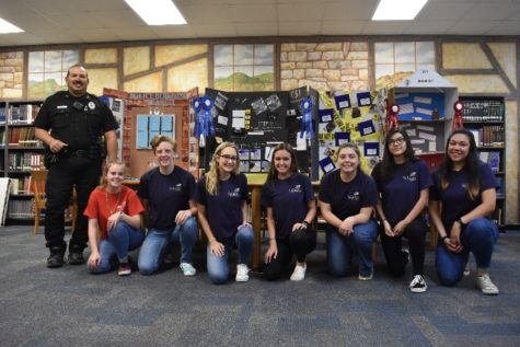 (Left to right) Officer Ayala, Hannah Ostendorf, Geneva Rose, Audrey Mills, Malory Jenschke, Piper Carrol, Jacquelyn Guevara, Lizbeth Ramirez
