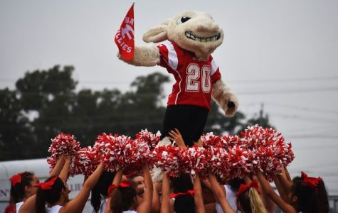 The Billie Mascot floats above the cheerleaders during the first pep rally of the year.