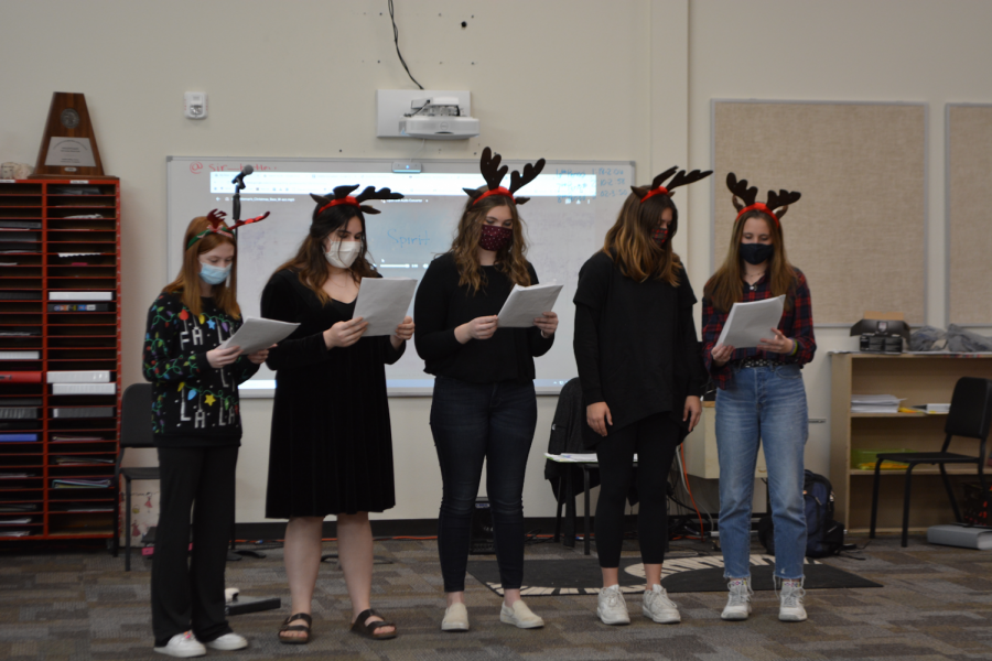 Choir+students+decked+out+to+record+their+Christmas+music.