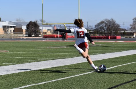 Senior midfielder Gabby Michalak draws back her leg to pass the ball inside the box.