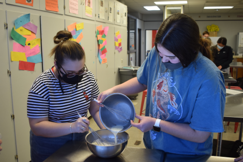 Students make muffins in Coach Taylor's food science class.