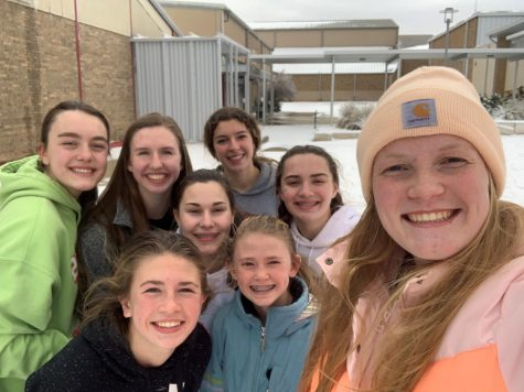 The girls varsity basketball team snapped a picture after their Friday practice.