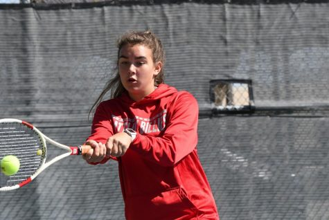 Chloe Wanek keeps her eye on the ball at the tennis tournament in Fredericksburg.